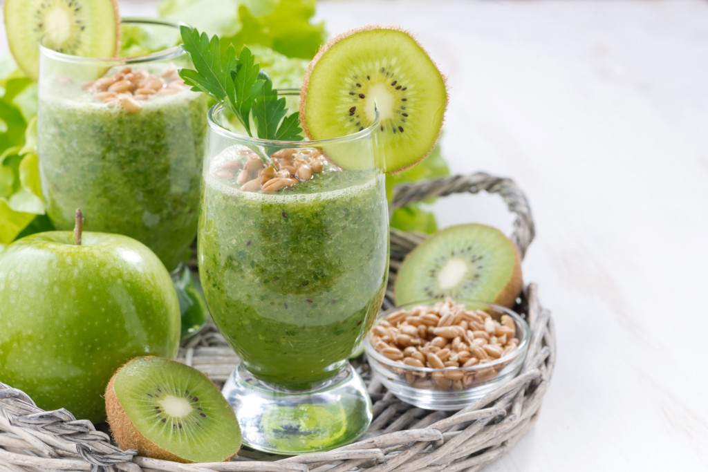 healthy green smoothie with sprouts and fresh ingredients