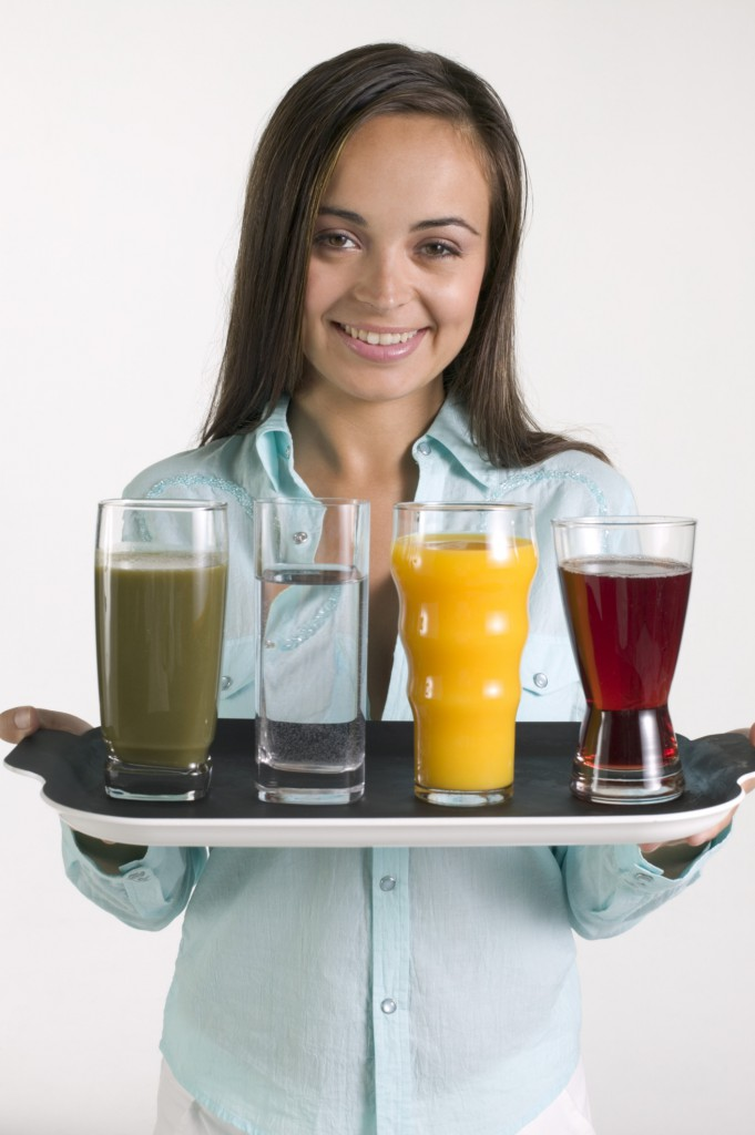 Woman holding tray with juice